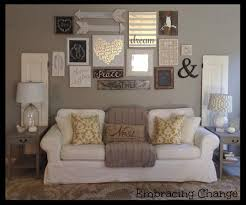 the space above your couch is the perfect place for a gallery wall featuring wooden decor inspirational sayings and family photos