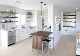 contemporary kitchen wooden open shelving wooden island metal stools wine fridge white cabinets pentant lamps