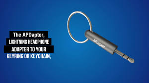 apple headphone adapter. apdapter - the original apple lightning to 3.5mm headphone jack adapter keyring / keychain