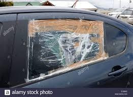 smashed broken rear car door window taped up as a temporary repair ushuaia argentina