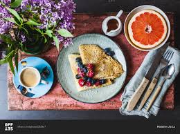 Table Setting For Breakfast Overhead View Of Breakfast Table Setting Of Berry Crepes Espresso