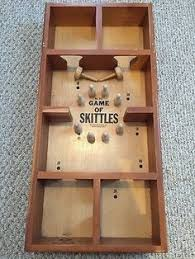 Skittles Wooden Board Game 100s Age old skittles game bowling sport on the table of 50