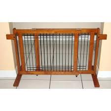 tall freestanding friendly wooden dog gate in a hallway pet gates uk