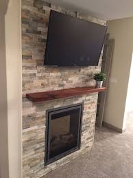 master bedroom accent wall with electric fireplace lennox for and cedar mantel mounted convector heater rustic