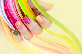 Colorful Multi Colored Manicure On A Short Nails On A Yellow