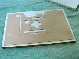 custom sized clamping boards are made from melamine shelves one board has relief holes to accommodate the mounting studs