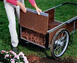 vermont garden cart woman lifting end to unload mulch into flower bed wheels
