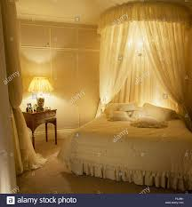 Lace Bedroom Curtains Coronet With Lace Curtains And Small Chandelier Above Bed In An