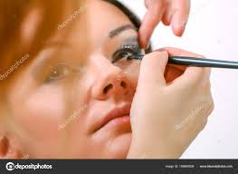 professional make up artist doing glamour model makeup at work stock photo
