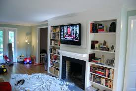 cable box wall mount tv above fireplace hide wires how