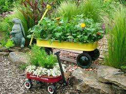 here is an example of a red wagon used as a portable garden container
