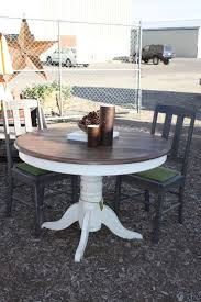 this kitchen table is pretty mon and is quite outdated in color but is actually quite beautiful and has tons of potential
