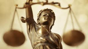 what is the difference between law and justice com