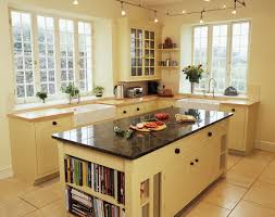 simple small country style kitchen decoration ideas with white wooden cabinet and island with bookshelf and marble countertop plus led track lighting
