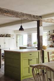 green country kitchens. country kitchen with island unit painted green oak worktop and pendant light. design kitchens n