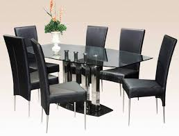 luxurious black dining room sets with cushioned dining chairs and glass dining table for modern dining room ideas