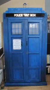 a bookcase shaped like a blue uk police call box omnium design