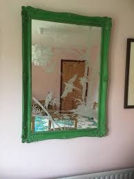large ornate etched vintage mirror in a solid wood decorative frame