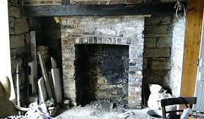 opened up fireplace with rebuilt arch restoring brick clean red chimney