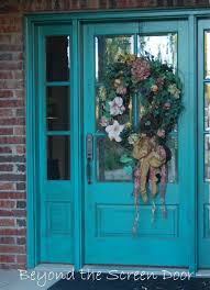 Exterior Design Blue Color Of Front Door Are Welcoming The Visitor Has  Flowers Hanging There The
