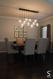 lighting for dining room ideas. Dining Room Charming Green Curtains Blue Glass Chandelier High Back Best Design Ideas Pendant Lighting For