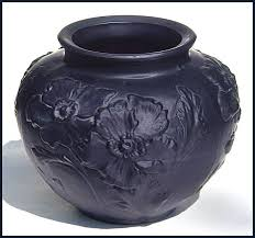 tiffin glass black amethyst poppy vase black amethyst satin glass vase with raised poppy like flowers looks purple when held up to the light 5½ h