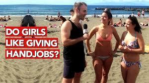 Women giving hand jobs on beach