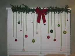 tremendous red ribbon combine to colorful tree bulbs with fir twig on top window decorations