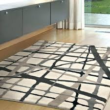 8x10 area rugs carpets layer an abstract rug in your room for a contemporary vibe