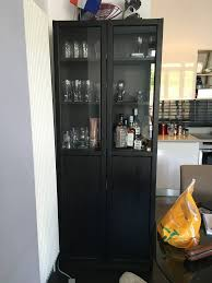 ikea hemnes cabinet with panel glass door black brown