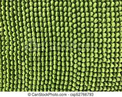 Green carpet or fabric texture and background Close up view
