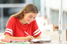 Happy Student Girl Studying Taking Notes Sitting In A Coffee.. Stock Photo, Picture And Royalty Free Image. Image 85272189.