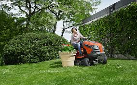 husqvarna garden tractor. A Woman Mowing Her Lawn On Husqvarna Tractor Garden