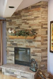 ledge stone fireplace over drywall with oak mantel and raised hearth project in lake forest il customer painted brass doors to flat black