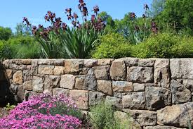 interior appealing concept for stunning retaining wall ideas with rock material plus beautiful purple flowers