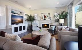 modern tropical living room with fireplace and tv