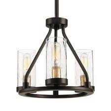 hartwell 3 light antique bronze mini pendant with clear seeded glass and natural brass