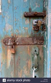 old rusty padlocks on a old distressed door