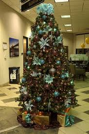 Teal and brown Christmas tree with peacock feathers! I really need to get  into a