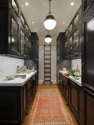 Wonderful Black Galley Style Kitchen Features A Row Of Hicks Pendants Illuminating  Glass Front Upper Cabinets Fitted With Brass Ladder Rails And U2026