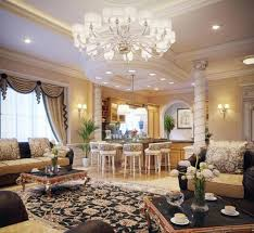 brass chandelier over living room and 2 lights pendant lamp and false ceiling recessed lights