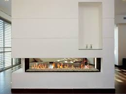 inspiring white double sided gas fireplace room divider design with vertical wall insert storage decoration idea