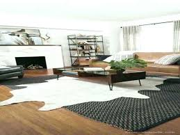 brown and white faux cowhide rug silver black cow furniture magnificent a living room space with