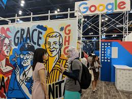 hundreds of booths line the room the size of an airplane hanger you make your way to the google booth where you meet a google engineer and