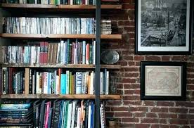 hanging shelves on brick wall the reclaimed wood look great putting floating w shelves on brick wall