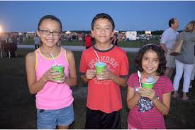 Lakewood Ranch celebrates anniversary - Sera, Elliott and Ava Nelson, of  East County, snack on snow cones. | Your Observer