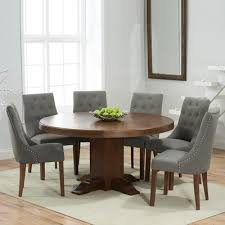 trina dark solid oak round dining table with 6 primly grey chairs 7045