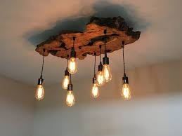 custom made medium live edge olive wood chandelier rustic and with rustic industrial lighting