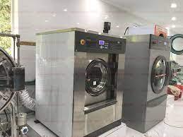 Lắp đặt máy giặt sấy công... - Máy giặt công nghiệp Oasis
