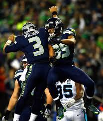 Russell Wilson, Doug Baldwin - Russell Wilson and Doug Baldwin Photos -  Divisional Playoffs - Carolina Panthers v Seattle Seahawks - Zimbio